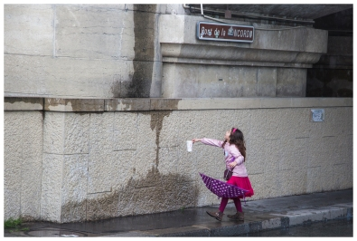 Street photography. Collecting rain 1, by the Seine in Paris, France